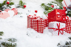 Christmas gift on snow Stock Image