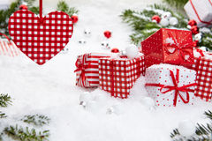 Christmas gift on snow Stock Photos