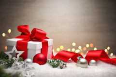 Christmas gift in snow, elegant background royalty free stock images