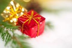 Christmas gift on snow macro Stock Photography