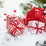 Christmas gift on snow Royalty Free Stock Photos
