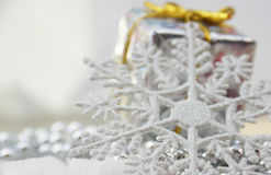 Christmas gift and snowflake Stock Image