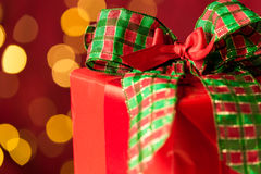Christmas gift and sparkling lights in background Royalty Free Stock Photography