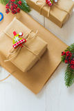 Christmas gift and a sprig of pine needles on a white  background Royalty Free Stock Image