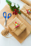 Christmas gift and a sprig of pine needles on a white  background Stock Photo