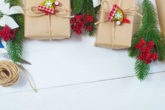 Christmas gift and a sprig of pine needles on a white  background Royalty Free Stock Photography