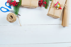Christmas gift and a sprig of pine needles on a white  background Stock Photography