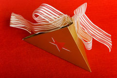 Christmas gift with star and bow Royalty Free Stock Photo