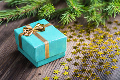 Christmas gift with stars on wooden table Royalty Free Stock Photography