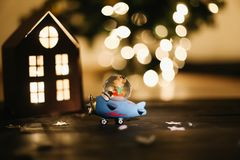 Christmas gift. Still life on dark background. New Year`s lights and decorations stock photo