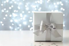 Christmas gift on table. Against blurred background stock photo
