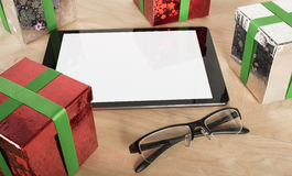 Christmas Gift with Tablet in wood Background Royalty Free Stock Photography