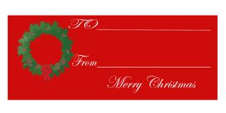 Christmas Gift Tag. Red Christmas gift tag with wreath Stock Photography