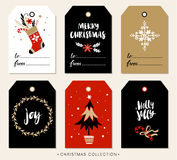 Christmas gift tag with calligraphy. Hand drawn design elements.