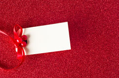 Christmas Gift Tag on Red Glitter Stock Photography