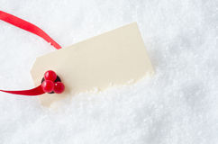 Christmas Gift Tag in Snow Stock Image