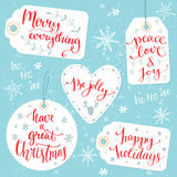 Christmas gift tags with calligraphy greetings Stock Photos