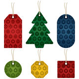 Christmas gift tags. Set of christmas gift tags, various shapes and colors with bauble pattern Stock Images
