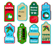 Christmas gift tags  set on white background. Red and blue seasonal stickers for sale or discount offer. Merry Christmas and Best wishes labels for present Royalty Free Stock Photography