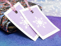 Christmas gift tags. With wallet on blue background Royalty Free Stock Photos