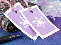 Christmas gift tags. With wallet and writing pen Royalty Free Stock Photos