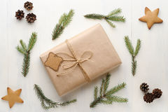Christmas gift, thread, pine cone, pine needles and Ginger Cooki Stock Images