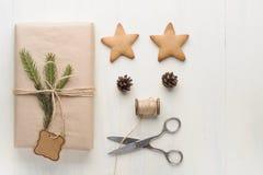 Christmas gift, thread, scissors, pine cone, pine needles. Stock Image