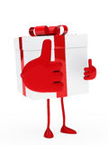 Christmas gift thumbs up. Red white christmas gift take thumbs up Royalty Free Stock Photography