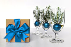 Christmas gift tied with blue ribbon and Christmas balls Stock Photo