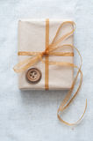 Christmas gift tied with ribbon Royalty Free Stock Photos