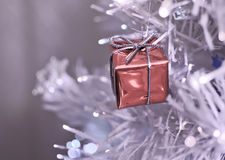 Christmas. Gift on the tree Royalty Free Stock Photo