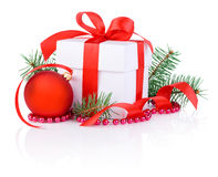Christmas gift, tree branch and christmas ball Stock Photos
