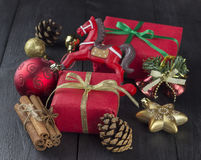 Christmas gift, tree decorations on wooden a background.  Royalty Free Stock Photos