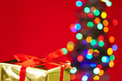 Christmas gift with tree and red background Stock Image