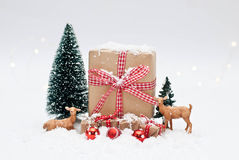 Christmas. Gift, tree and reindeers Stock Photography