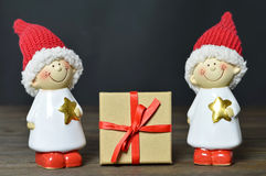 Christmas gift. And two Christmas elves Royalty Free Stock Photography