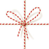 Christmas gift tying: bow-knot of red and white twisted cord. Vector illustration, eps10. Royalty Free Stock Photo