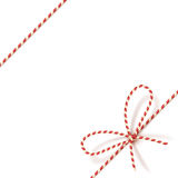 Christmas gift tying: bow-knot of red and white twisted cord. Vector illustration, eps10. Stock Photography