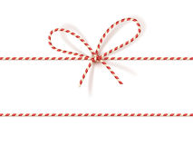 Christmas gift tying: bow-knot of red and white twisted cord. Vector illustration, eps10. Isolated on white christmas gift tying: bow-knot of red and white Stock Images