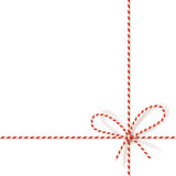 Christmas gift tying: bow-knot of red and white twisted cord. Vector illustration, eps10. Isolated on white christmas gift tying: bow-knot of red and white Royalty Free Stock Photo
