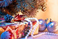 Christmas gift under a christmas tree Stock Photos
