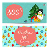 Christmas Gift Voucher with Prepaid Sum Template. Christmas gift voucher template. Gift coupon with Xmas attributes and prepaid sum. Cute snowman, wrapped gifts Royalty Free Stock Images