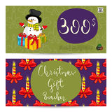 Christmas Gift Voucher with Prepaid Sum Template. Christmas gift voucher template. Gift coupon with Xmas attributes and prepaid sum. Cute snowman, wrapped gifts Royalty Free Stock Image