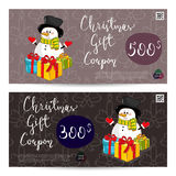 Christmas Gift Voucher with Prepaid Sum Template. Christmas gift voucher template. Gift coupon with Xmas attributes and prepaid sum. Cute snowman, wrapped gifts Royalty Free Stock Photo