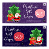 Christmas Gift Voucher with Prepaid Sum Template. Christmas gift voucher template. Gift coupon with Xmas attributes and prepaid sum. Santa, gifts, christmas tree Stock Photo