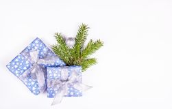 Christmas gift on white background with spruce branch. Shiny gift boxes on  white background. Copy space Stock Photos