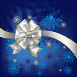 Christmas gift white bow bluet background Royalty Free Stock Photos