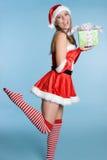 Christmas Gift Woman. Beautiful woman holding christmas gift Stock Photos
