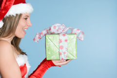 Christmas Gift Woman. Beautiful woman holding christmas gift Royalty Free Stock Photos