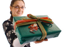 Christmas gift Woman. A woman holding a christmas gift, isolatedn on white Royalty Free Stock Photo